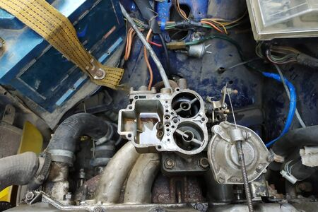 Adjustment of the motors valves on a VAZ brand by an auto locksmith in a garage, dirty hands. 2019