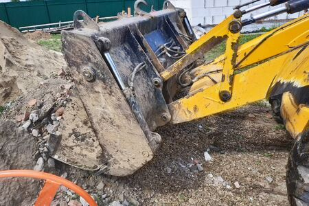 A bulldozer disposes of debris on the construction site of a private territory. 2019