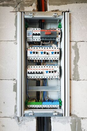 Built-in elementary shield on the wall of the house. 2019