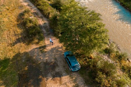 GOSHOV, UKRAINE - AUGUST 1, 2019, A car stands near the river bank in a field.