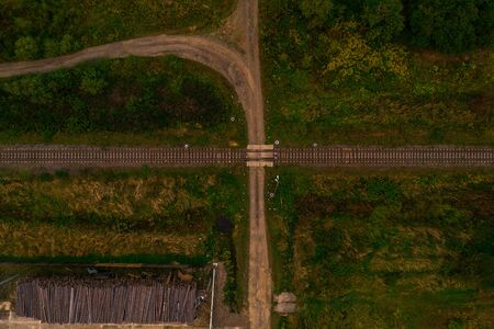 Aerial view shows the intersection of the railway tracks in the field. 2019
