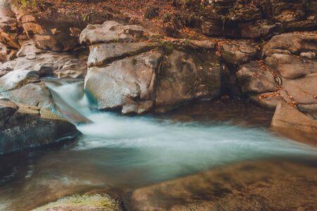 Mountain river stream closeup, large rocky rocks. 2019