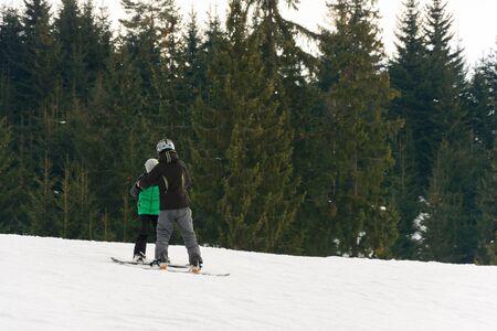 In the Ukrainian Carpathian village, children ski. 2019