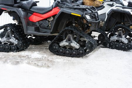 Closeup of snowmobile with snow at ski resort. 2019