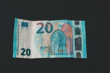 Twenty memorable euros lie on a black background.2019 版權商用圖片