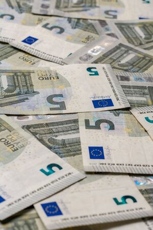 Texture with denominations of 5 euros, euro European currency. 2019