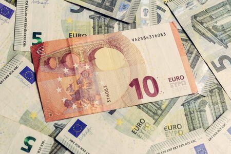 Euro banknotes, texture from 5 and 10 euros, ten euros outweigh five euros. 2019