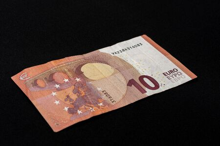European denomination of ten euros on black background. 2019