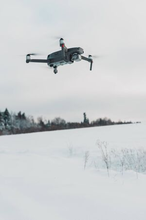 Running drone into the sky, quadcopter on blue sky background.2020