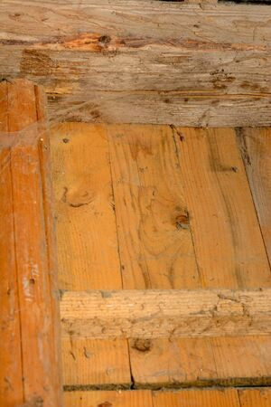 Many spider webs splashed on the wall with spider supports, the wall made of wooden horizontal boards. 2019