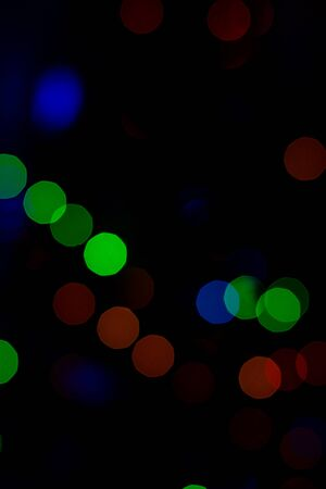 Bokeh of colored round festive Christmas lights.2020
