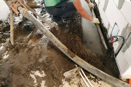 Employee performs sand-cement floor screed, Sand-cement floor screed for heating.2020 Stok Fotoğraf