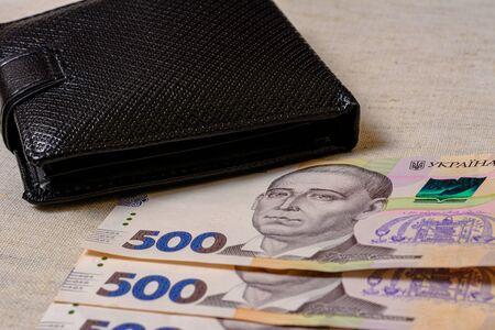 Five hundred Ukrainian hryvnia banknotes in black purse.2020