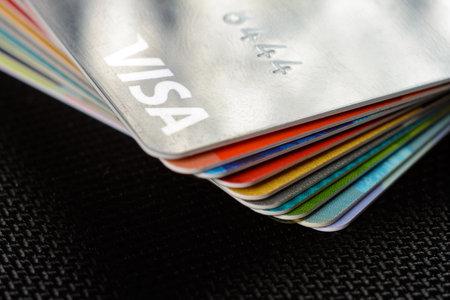 Lviv, Ukraine - 26 April 2019 : Close-up of Visa credit cards placed on a dark background 2020 Publikacyjne