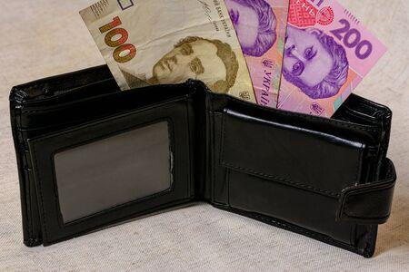 100 and 200 hryvnia in a black wallet on a gray background 2021. Zdjęcie Seryjne