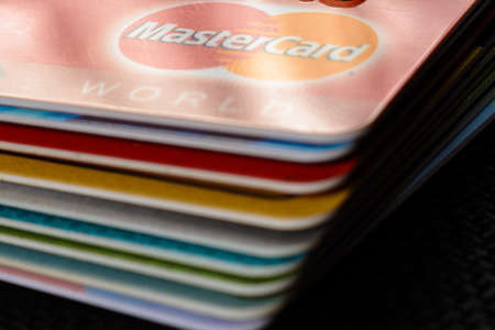 Lviv, Ukraine - 26 April 2019 : Close-up of mastercard credit cards placed on a dark background 2020