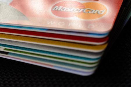 Lviv, Ukraine - 26 April 2019 : Close-up of mastercard credit cards placed on a dark background 2020