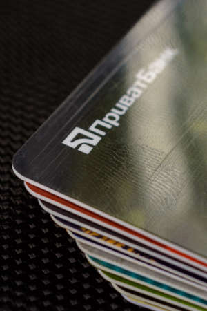 Lviv, Ukraine - 26 April 2019 : Stack of colorful credit cards of the Ukrainian bank titled PrivatBank 2020 Publikacyjne