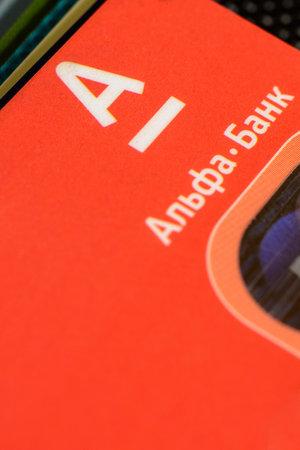 Lviv, Ukraine - 26 April 2019 : Stack of colorful credit cards of the Ukrainian bank titled AlfaBank 2020