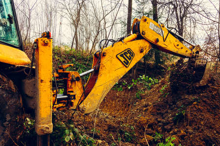 Trostyanets, Ukraine December 20, 2019: excavator digs soil in a village in a private yard.2020