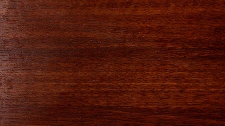 Varnished red tree with original texture. Beautiful brown wood background on lacquered textured plywood.
