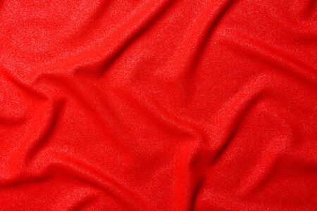 Texture of luxurious red silk fabric. Layout of a flag for training during design work on a colorful background 2021.