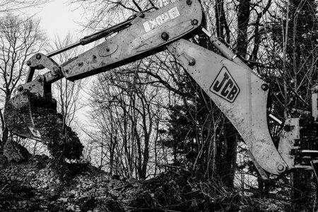 Trostyanets, Ukraine December 20, 2019: excavator digging soil in forest.2020 Publikacyjne