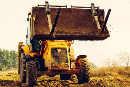 Trostyanets, Ukraine December 20: excavator transports concrete slabs to the yard.2020 Publikacyjne