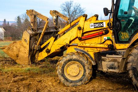 Trostyanets, Ukraine December 20: excavator digs soil in village2020