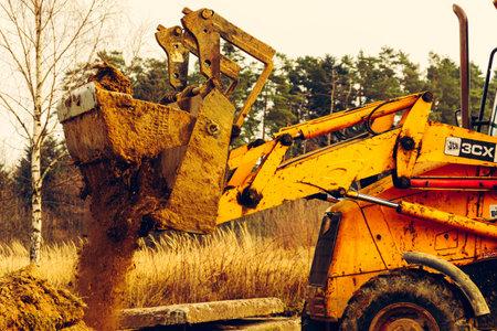 Trostyanets, Ukraine December 20: excavator digs soil in village.2020