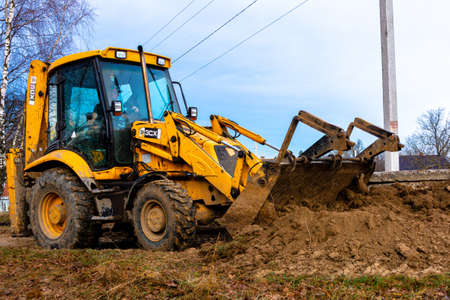 Trostyanets, Ukraine December 20, 2019: excavator in the village collects soil with a ladle.2020