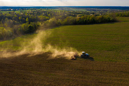 The process of preparing the land for sowing cultivated plants, view from the top of the field cultivation process, Ukrainian fertile lands. 2021