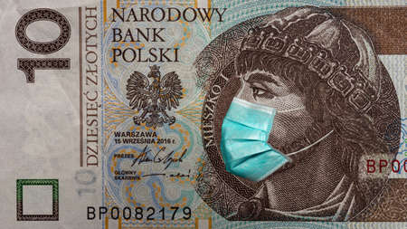 Banknote of 10 zlotych depicting polan Meshko in a medical mask during the economic crisis and pandemic of the coronavirus in Poland. Qualitative montage closeup.