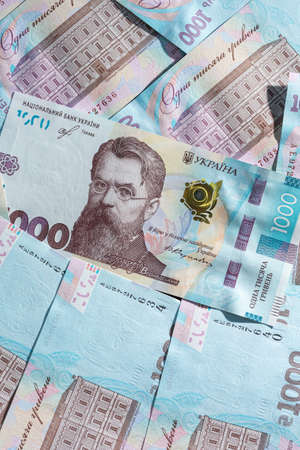 Ukrainian hryvnia in the face value of one thousand hryvnias, texture of one thousand hryvnia banknotes close-up. 2021
