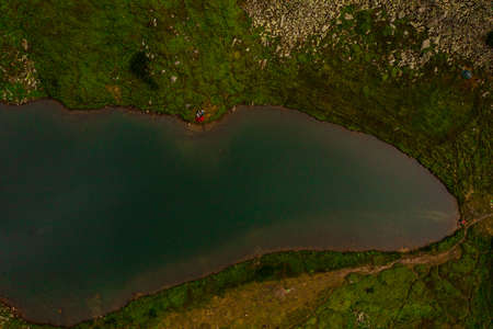 High-altitude lake of the Ukrainian Carpathians, Lake Brebeneskul, the pearl of the Carpathians, a calm and ecologically clean reservoir.