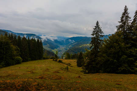 Ukrainian picturesque Carpathian village Luhy, located at the foot of many mountains and near the river Bila Tysa.