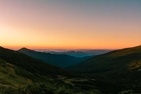 Picturesque landscapes of the Carpathians, before sunrise there is a light fog, sunrise in Montenegro. 2020