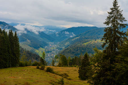 Ukrainian picturesque Carpathian village Luhy, located at the foot of many mountains and near the river Bila Tysa. 2020