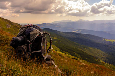 Backpack, the main element or thing in the campaign, a backpack on the background of the Carpathian mountains, the Carpathians of Ukraine. 2020