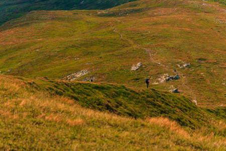 Tourist couple enjoys the views of the Montenegrin ridge, mountain range, Carpathian mountains, tourists in the mountains.2020