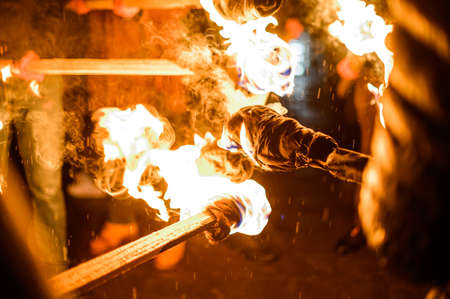 Flame on a homemade torch, fire on the background of night streets, peaceful actions with torches. 2020