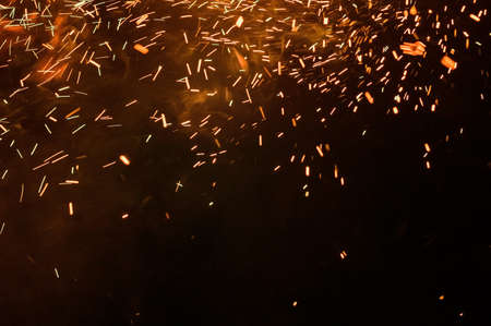 close up of sparks from fire, sparks on black background, extravaganza of fire, magic with sparks. 2020