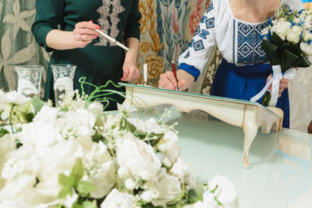 wedding ceremony in the registry office, close-up rings, vows of brides and dressing rings. 2020 Фото со стока