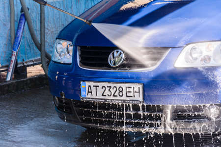 Ivano-Frankivsk, Ukraine August 14, 2020: self-service car wash, car wash at a cheap car wash in the city. 2020