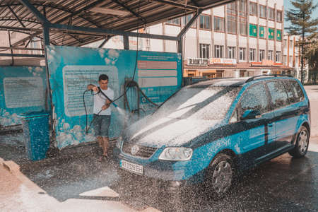 Ivano-Frankivsk, Ukraine August 14, 2020: a man at a self-service car wash. 2020