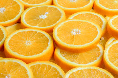 Texture of sliced orange, fresh and healthy fruit, which is rich in juice and vitamin c. Orange background 2021. 版權商用圖片