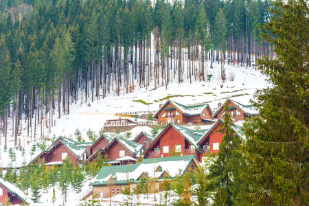 Beautiful view of winter resort with hotels and ski slopes surrounded by picturesque Carpathian mountains. 2019