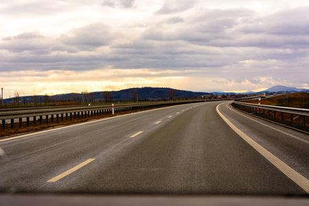 Empty track outside city with fields and road marking 2020 Zdjęcie Seryjne