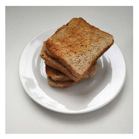 Square crispy and fragrant toast on a white plate, toast for breakfast. 2021