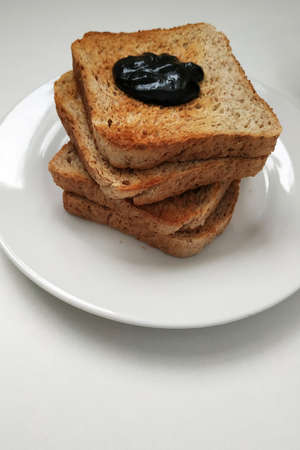 Crispy longing with chocolate for breakfast, toast and chocolate on a white plate. 2021